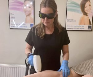 Kate applying a Laser Treatment